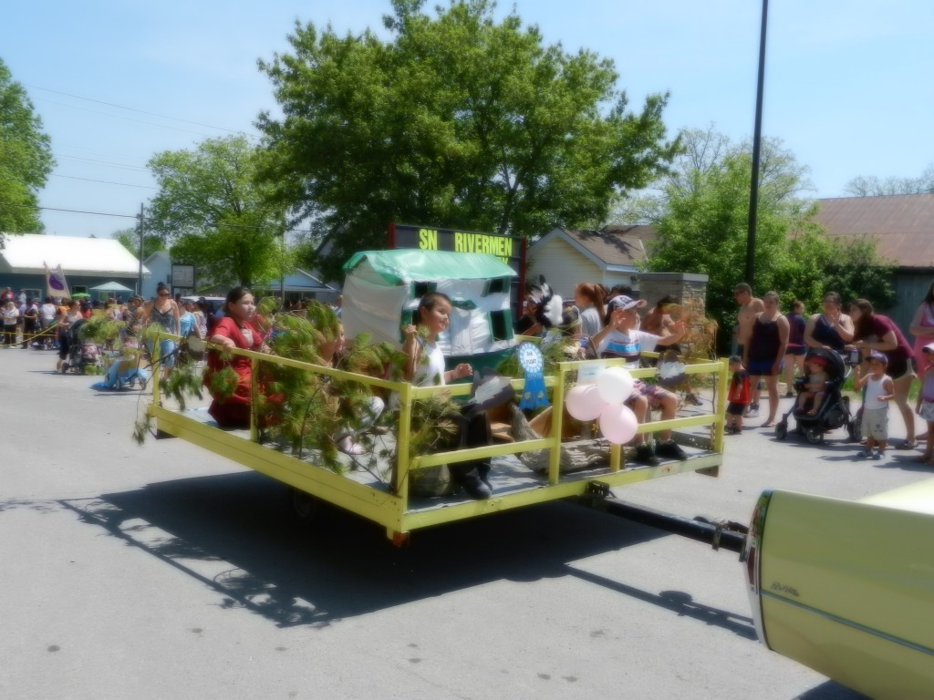Parade float, child waving in 2013 on Bread and Cheese Day